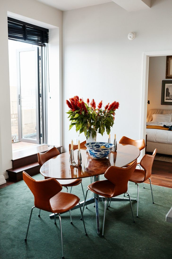Inside Radens Founders Brooklyn Apartment Green Carpet Tan Leather Chairs Blue Blown Glass