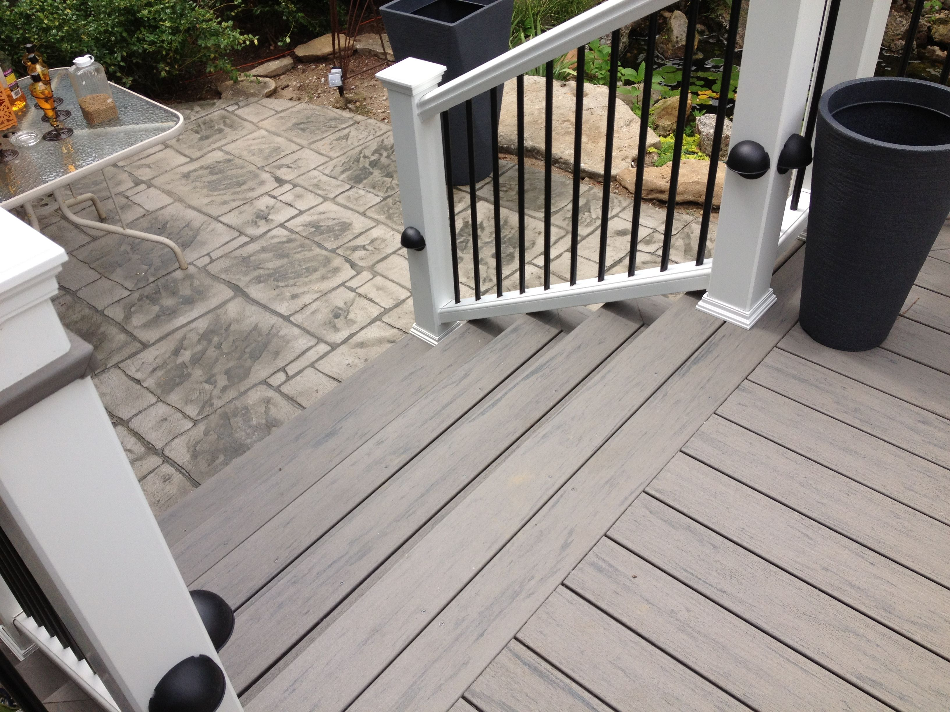 Double picture framed decking and stamped concrete patio Terrain decking