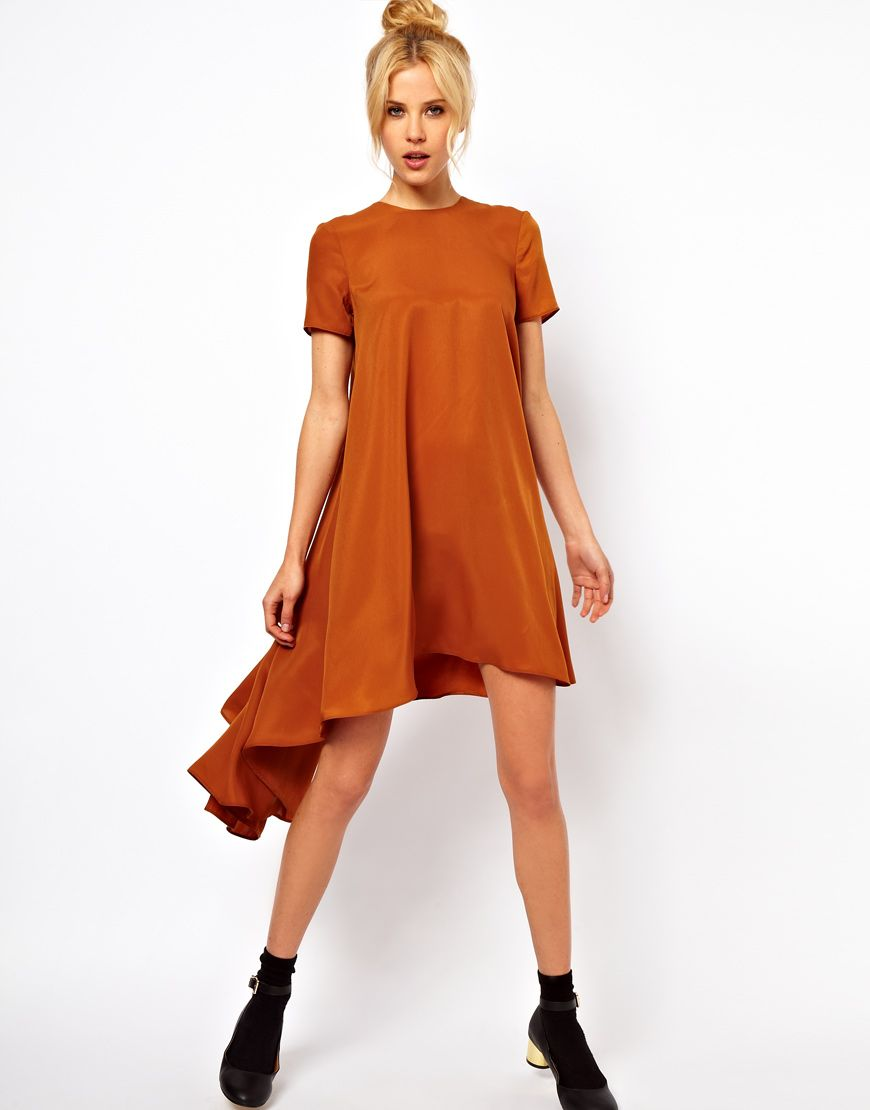 Tshirt dress with dipped hem so wearable and comes in black