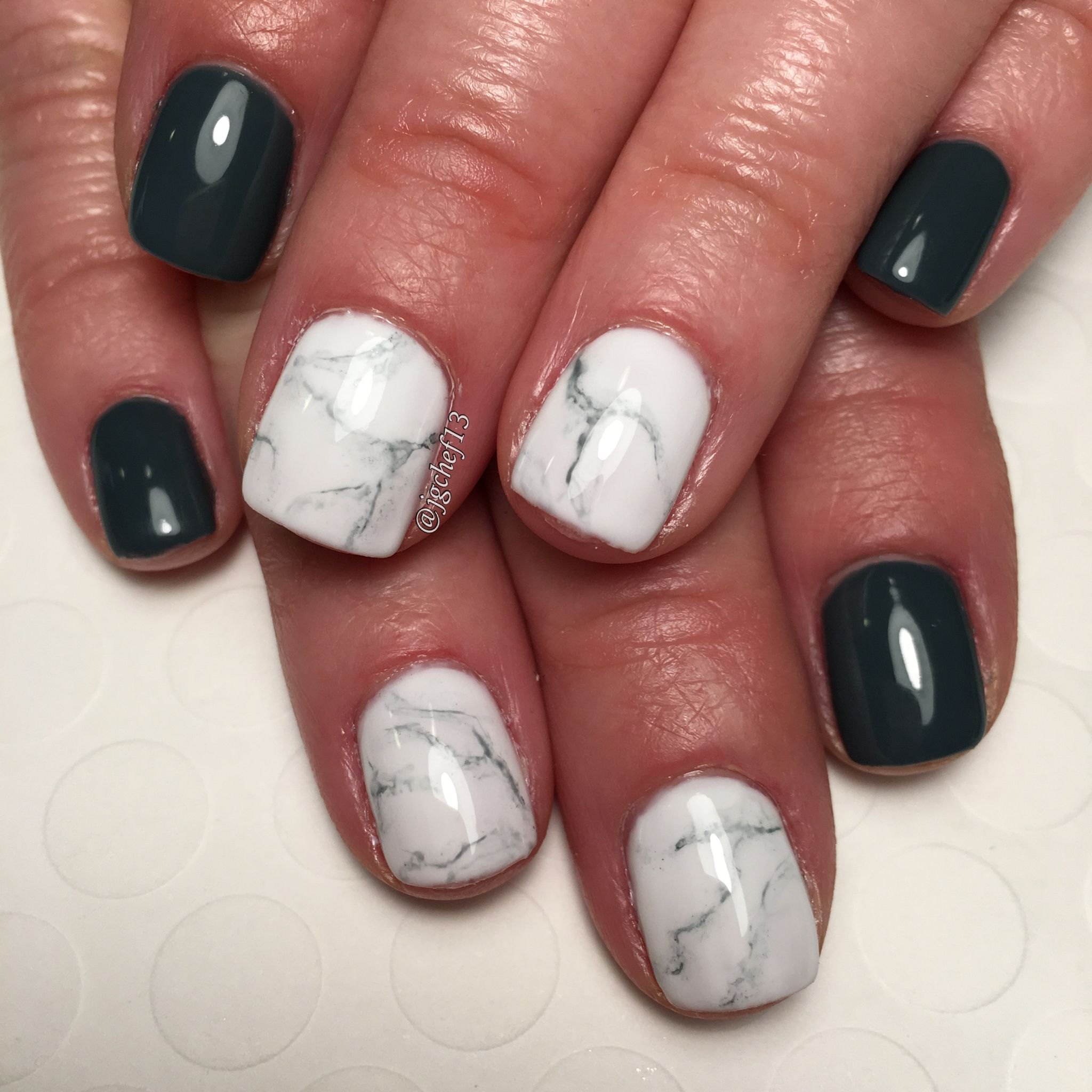 Dark gray blue with marble accent nails. See more of my designs on my nail board @jgchef13 or my IG account @jgchef13.