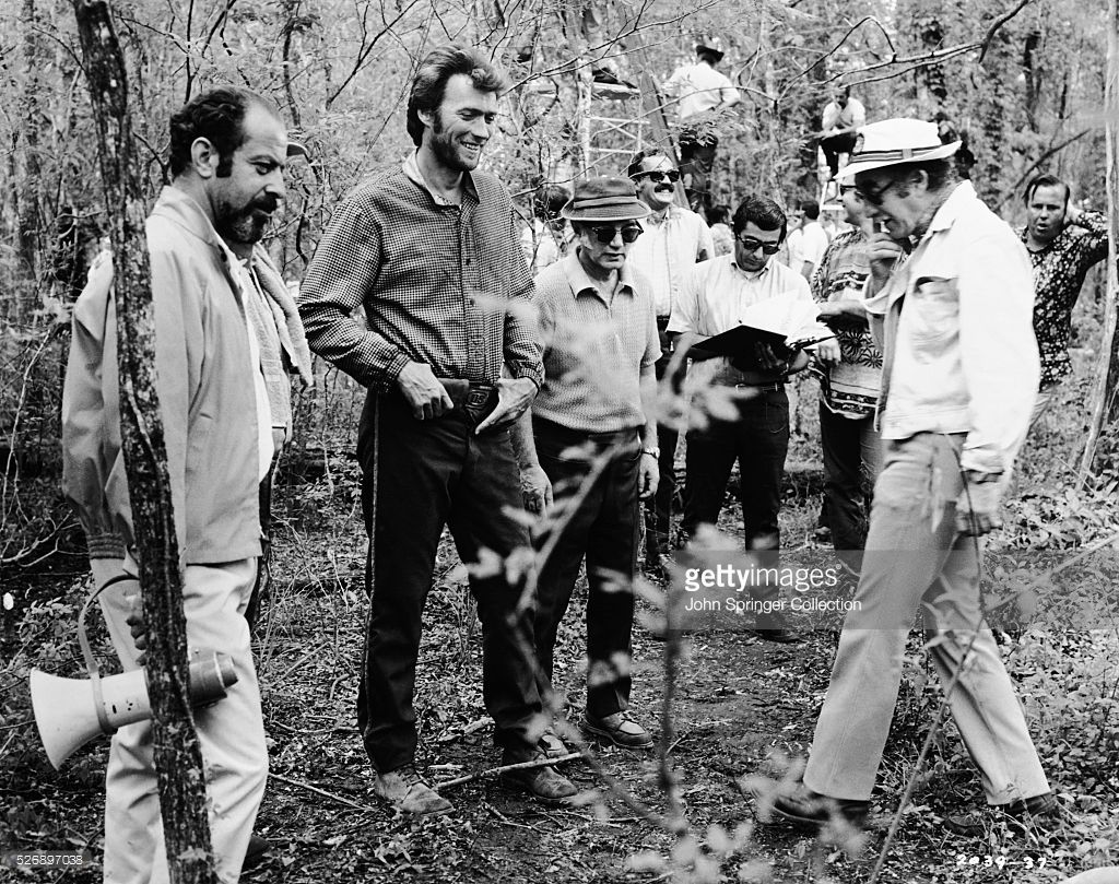 Director Don Siegel directs actor Clint Eastwood on the