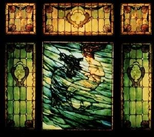 """This window owned by Carl Heck is a centerpiece in the """"Tiffany: Color and Light"""" exhibit. Titled """"The Mermaid"""" it is composed of six separate panels and measures 9 feet tall and 9 feet wide. Heck discovered it in Hawaii. Photo courtesy Carl Heck"""