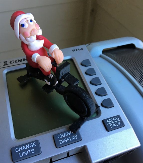 Rowing Santa Christmas Ornament