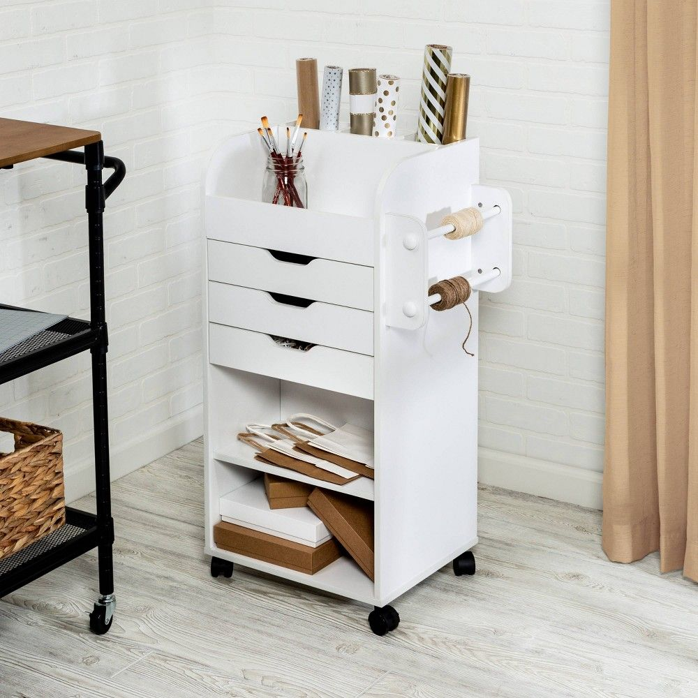 Honey-Can-Do CRT-06346 Rolling Craft Storage Cart, White. Keep your crafting materials organized with this convenient, rolling storage cart. Featuring three built-in storage drawers and two dowels for hanging ribbon, this storage center is ideal for storing crafting supplies or gift wrapping necessities. Also included are two built-in shelves and slots for storing rolls of wrapping paper. Flat, upper storage area is great for organizing smaller items. Four wheels make this cart portable and allo