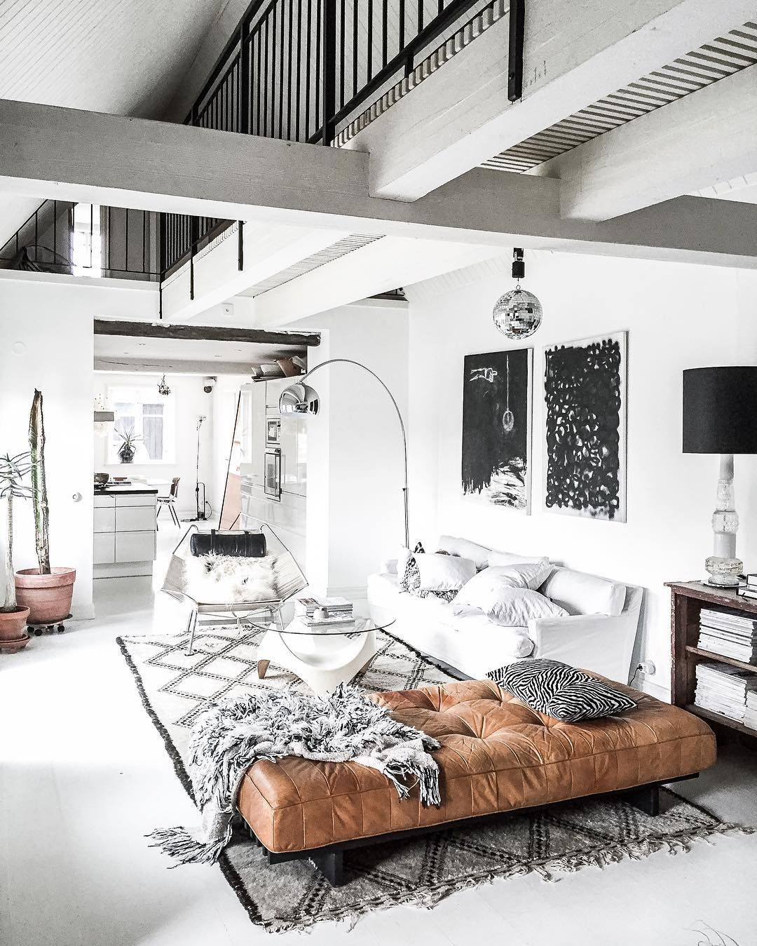 Bright White Living Space With A Morrocean Area Rug A Leather