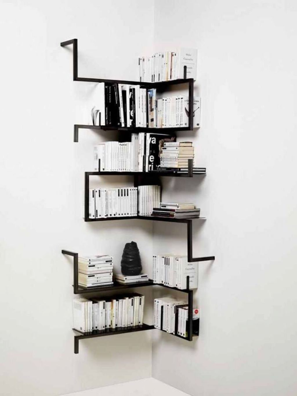 Contemporary Corner Shelves Mounted In The White Walls For Books Storage