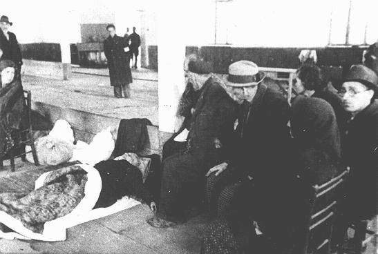 """Jews from Bulgarian-occupied Macedonia and Thrace interned at the """"Monopol"""" tobacco factory, used as a transit camp, before deportation to the Treblinka killing center. Skopje, Yugoslavia, March 11-31, 1943."""