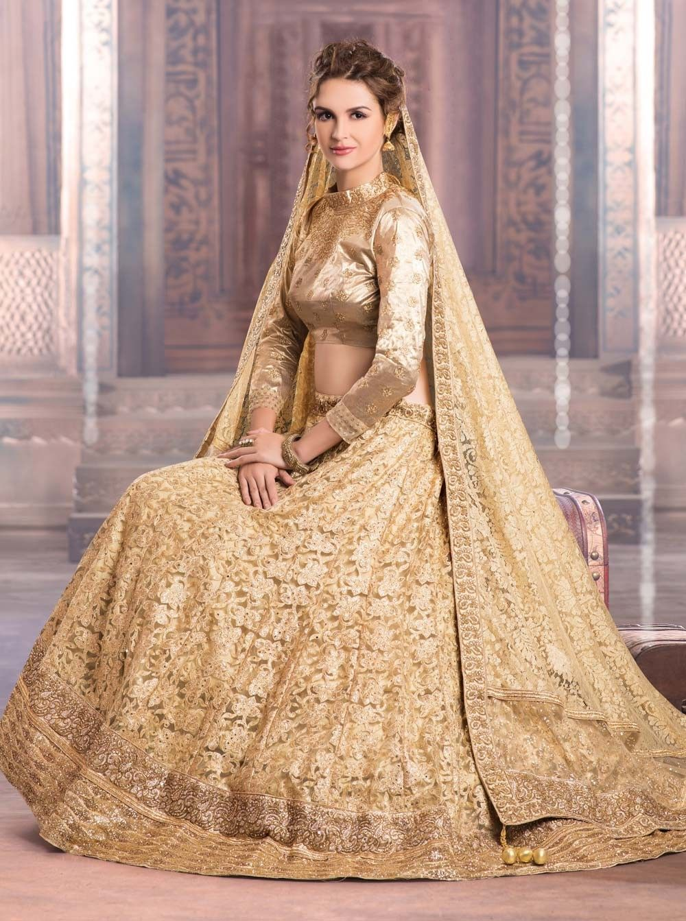Image result for indian bride gold lehenga with blue border | saree ...
