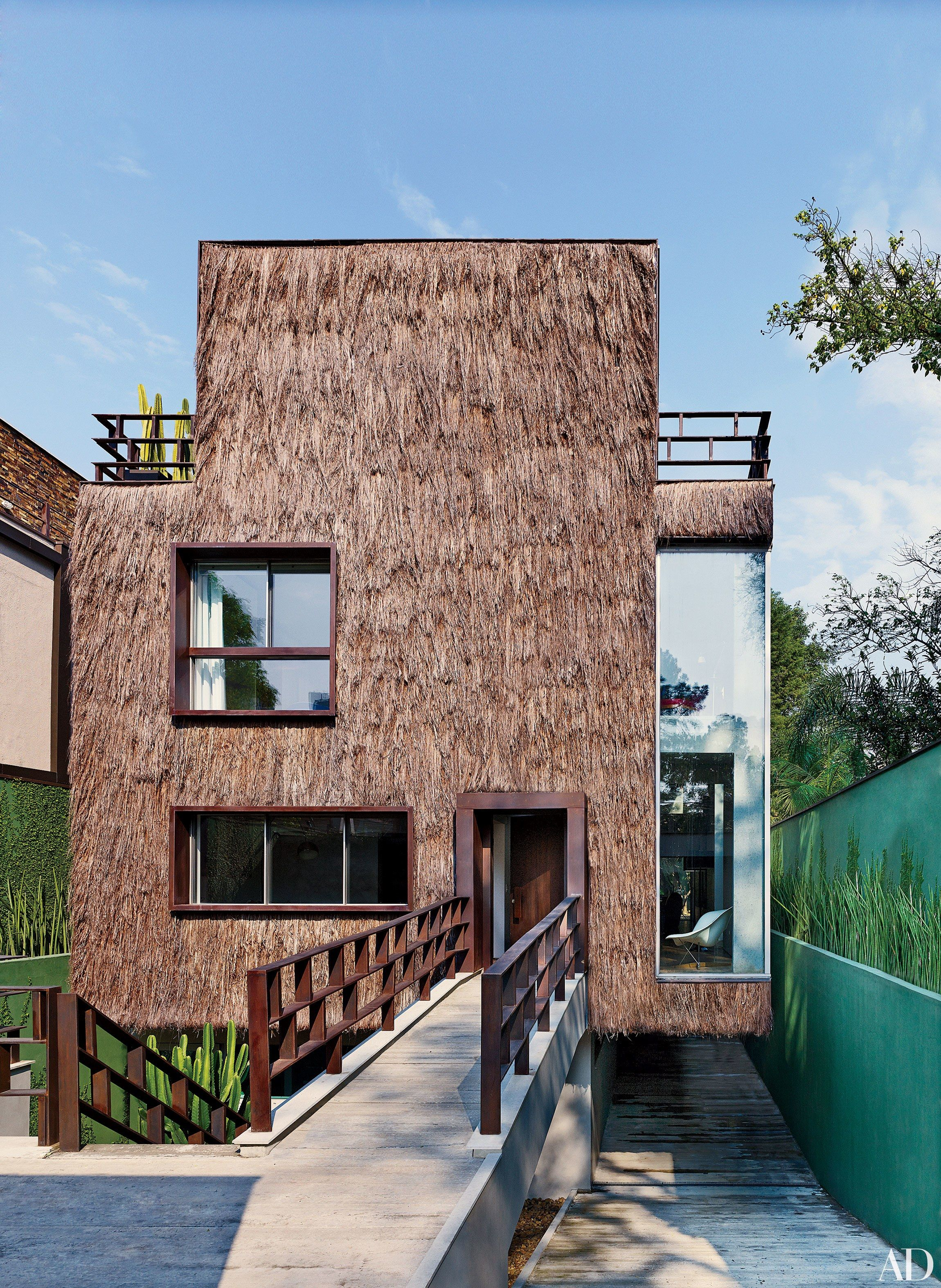 Take a Closer Look at These 7 Textured Home Exteriors from the AD Archives Photos: the Campana brothers, Humberto and Fernando, designed this São Paulo home clad entirely in shaggy piaçava-palm straw | Architectural Digest