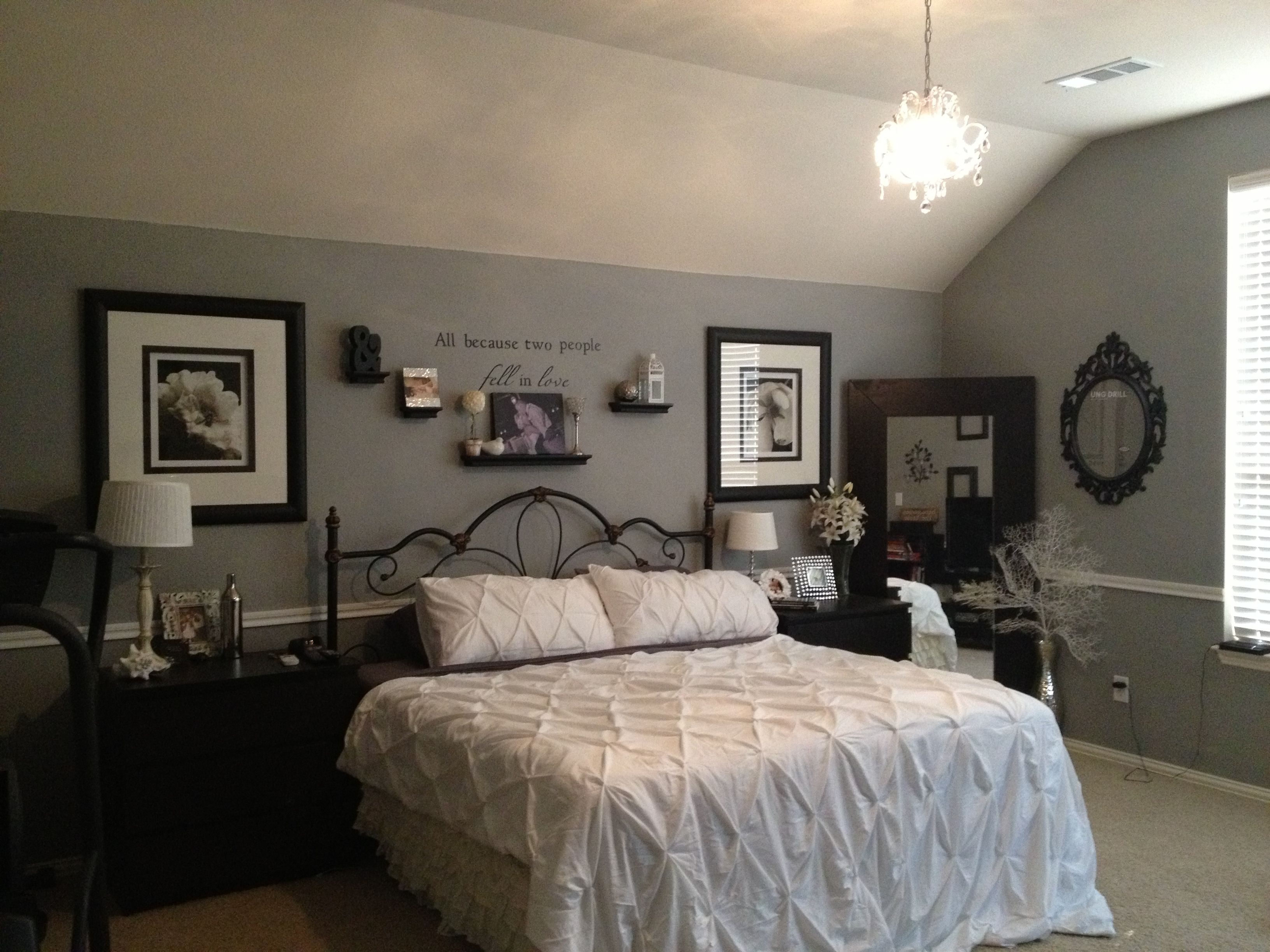 Bedroom. Gray, white, black with chair rail and Chandelier