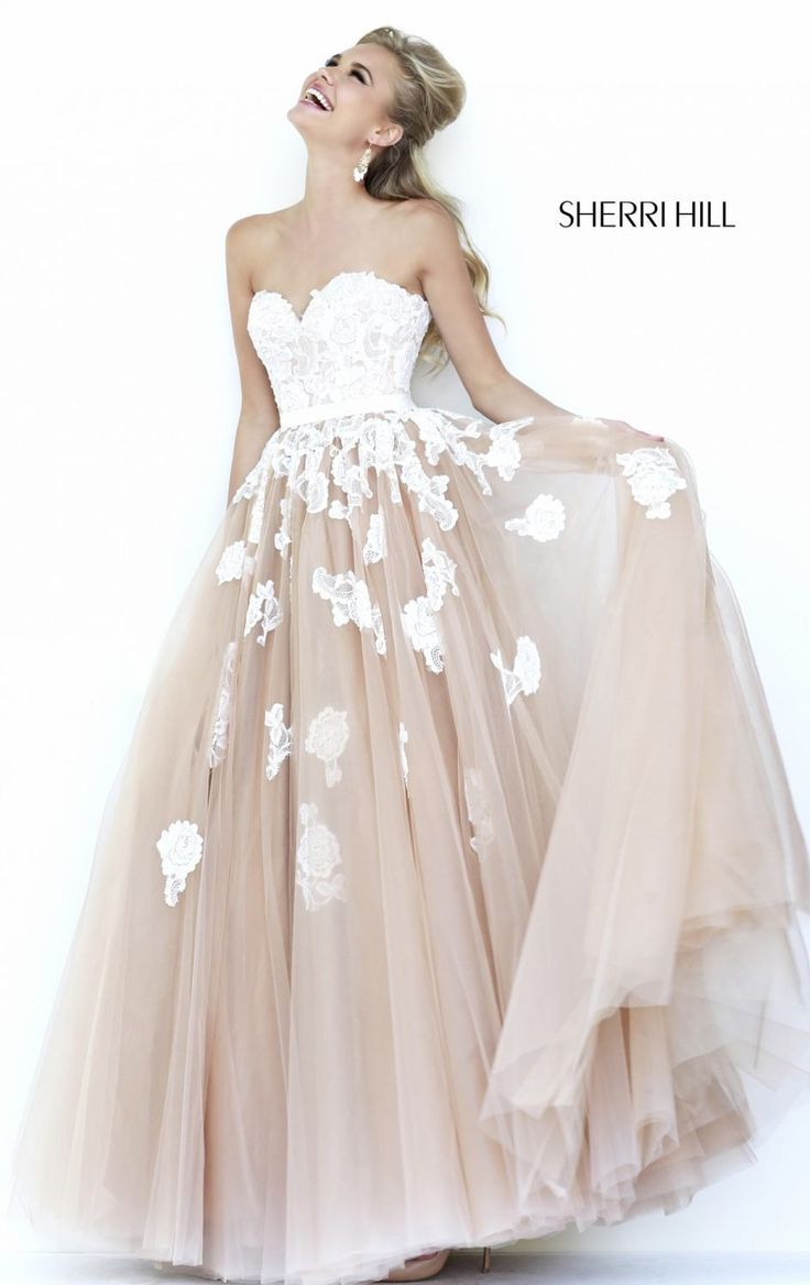 I would wear this as my wedding dress if the bottom was a lighter