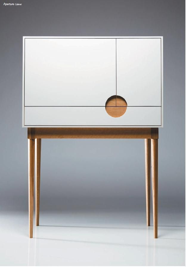 The Aperture cabinet. Tall cupboard with circular opening detail. Simple  but stunning!
