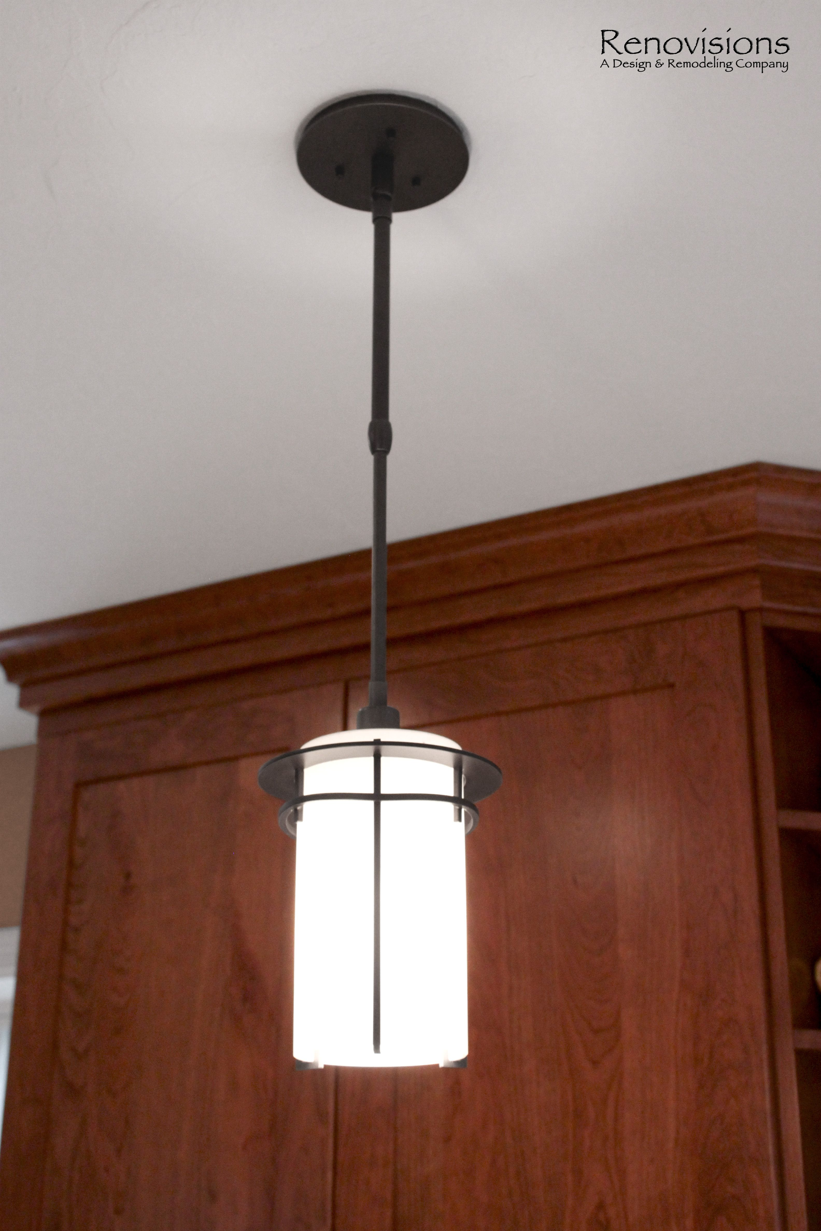Kitchen remodel by renovisionscherry cabinets pendant light