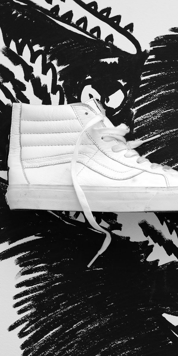 All white Vans Sk8-Hi's available now. Find your fit.