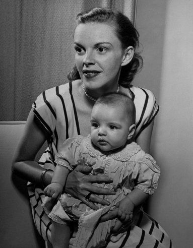 Judy Garland holds her daughter, Liza, at home in Hollywood in 1946