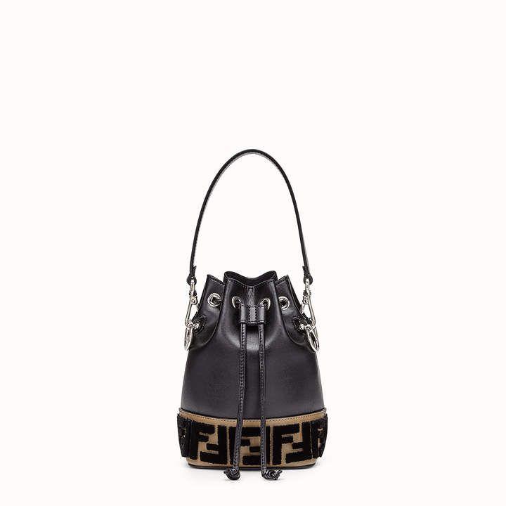 26748ea08327 Fendi MON TRESOR - Black leather mini-bag Small Mon Tresor bucket bag with  drawstring fastening and metal decorations in the Fendi logo shape.