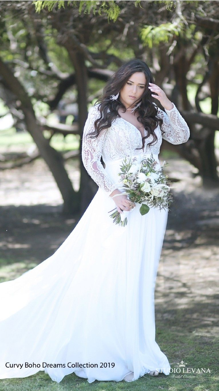 Bohemian plus size wedding gown with a stunning unique lace and long