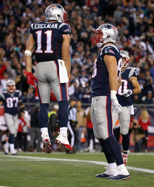 38c15cdaacd Julian Edelman Photos Photos - Julian Edelman  12 of the New England  Patriots reacts after scoring a touchdown during the fourth quarter against  the Miami ...
