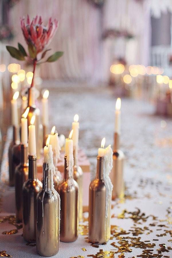 gold spraypainted wine bottles as candlesticks