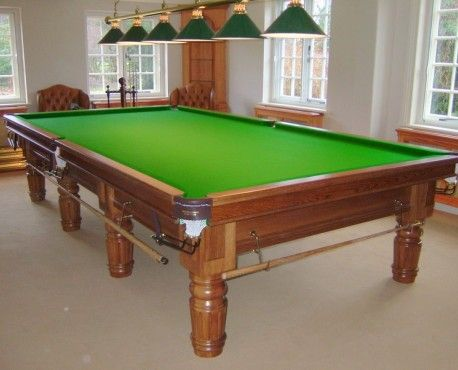 Connoisseur 12' x 6' Table Straight Turned Fluted Legs. Full size traditional snooker table manufactured in oak with a light golden oak stain with satin finish Brass fittings, brown leather pockets with all games rail and green 6811 tournament 'West of England' cloth. Matchplay 'Northern Rubber' fitted as standard. Shop here: http://www.snookerandpooltablecompany.com/snooker-tables/traditional-bespoke/connoisseur-12-x-6-table-straight-turned-fluted-legs.html