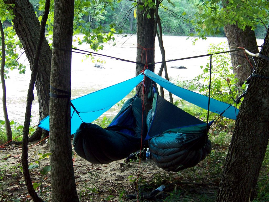 Medium image of on the left a haab  hook and attached bag  hammock with a speer peapod on the right a hennessy with a speer snugfit underquilt