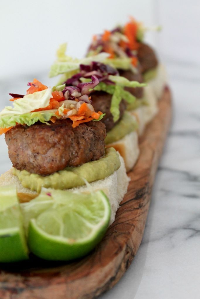 These pork sliders are the best thing you'll throw on your grill this summer - slathered with a spicy avocado mayonnaise and topped with lime-infused slaw, what more could you ask for!?