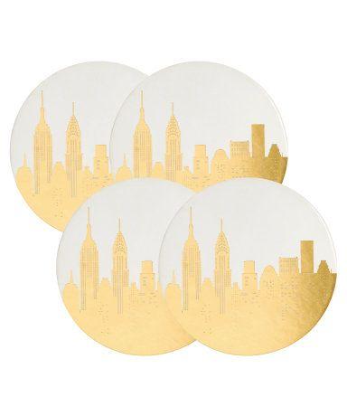 Valkoinen/New York. Painokuvalliset lasinaluset pahvia. Halkaisija 10 cm.