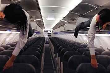 21 Photos Of Flight Attendants Having Fun In Overhead Bins