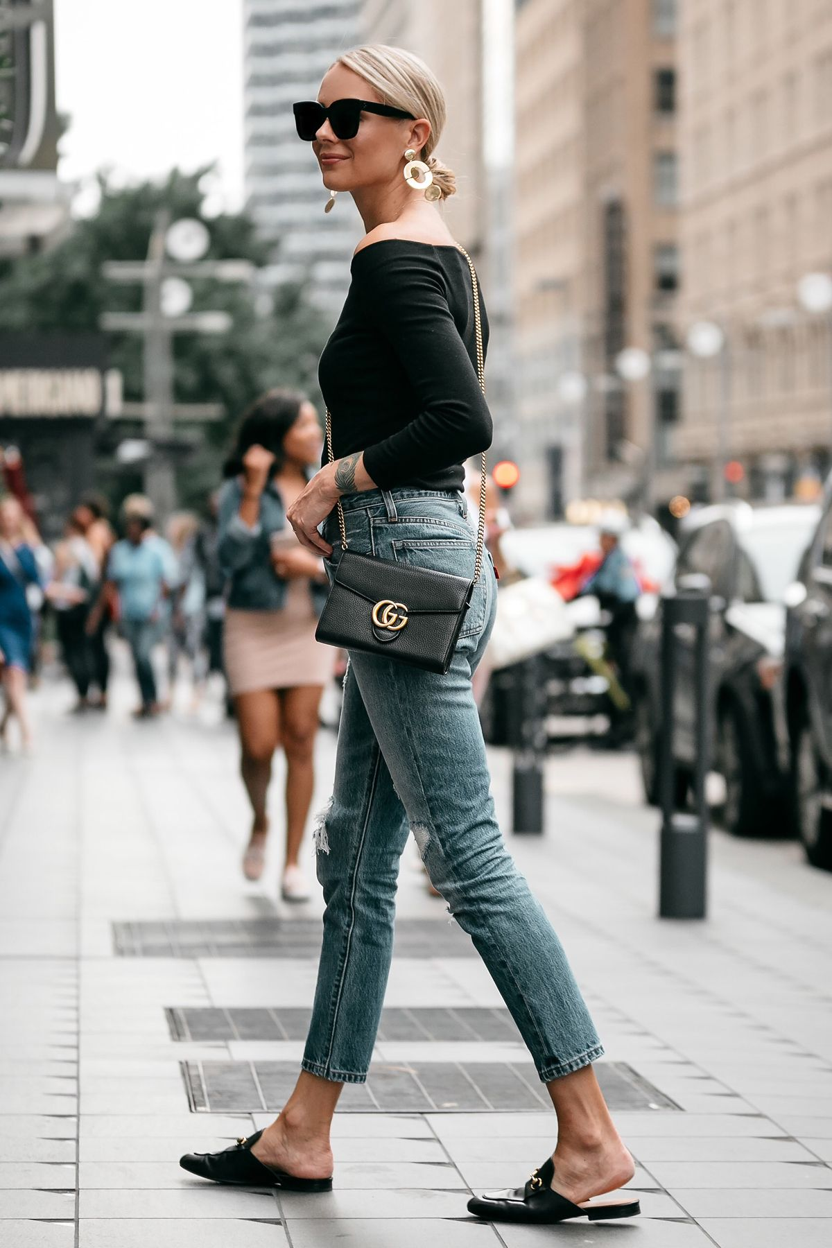 ed9e8d5014 Blonde Woman Wearing Jcrew black off the shoulder top Levis Denim Ripped  Jeans Gucci Marmont Handbag Gucci Princetown Loafer Mules Fashion Jackson  Dallas ...