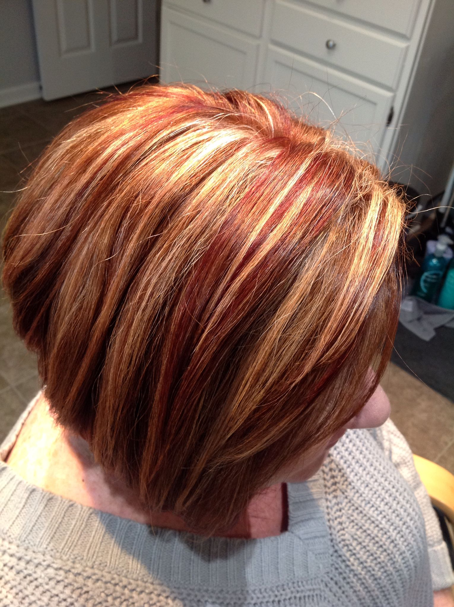 Copper base, red lowlights and chunky blonde highlights ...