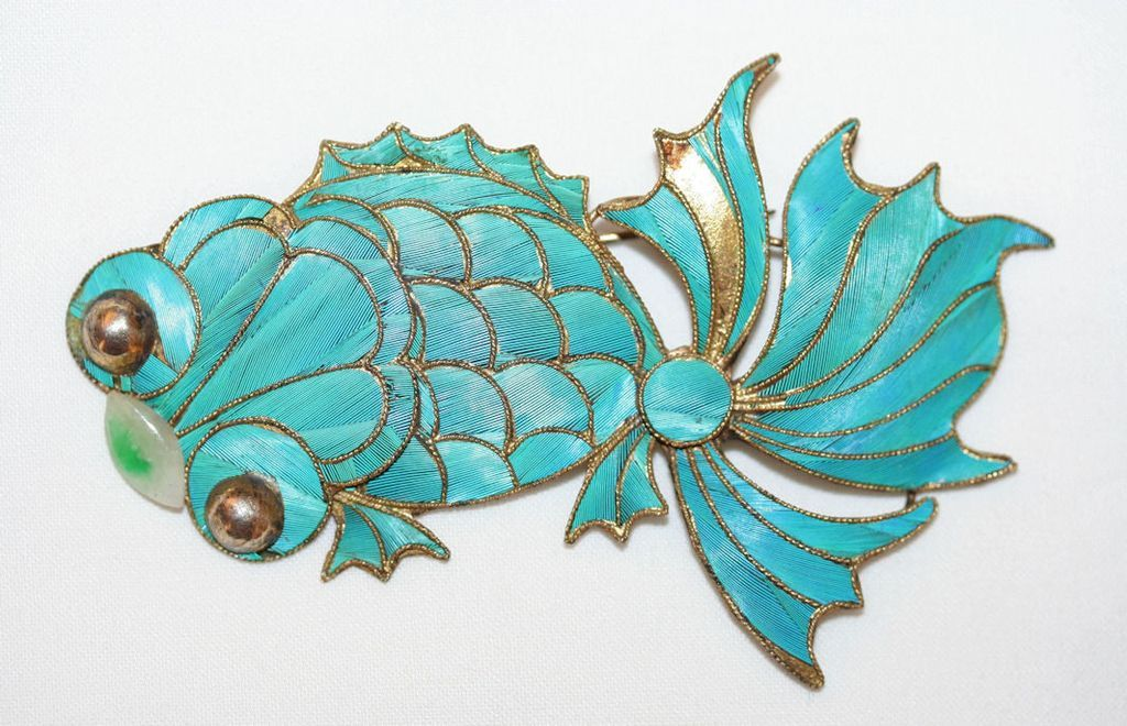Interesting mid-century Chinese export Kingfisher feather brooch in the shape of a koi, with jadite accent. Generally, Kingfisher pieces were made in the earlier 20th century; this piece is an homage to older stylistic sensibilities.