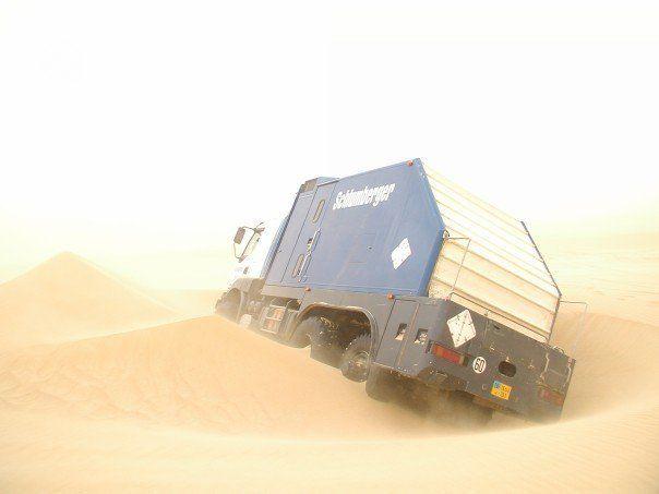 Schlumberger wireline truck, stuck  Mud or sand, not sure