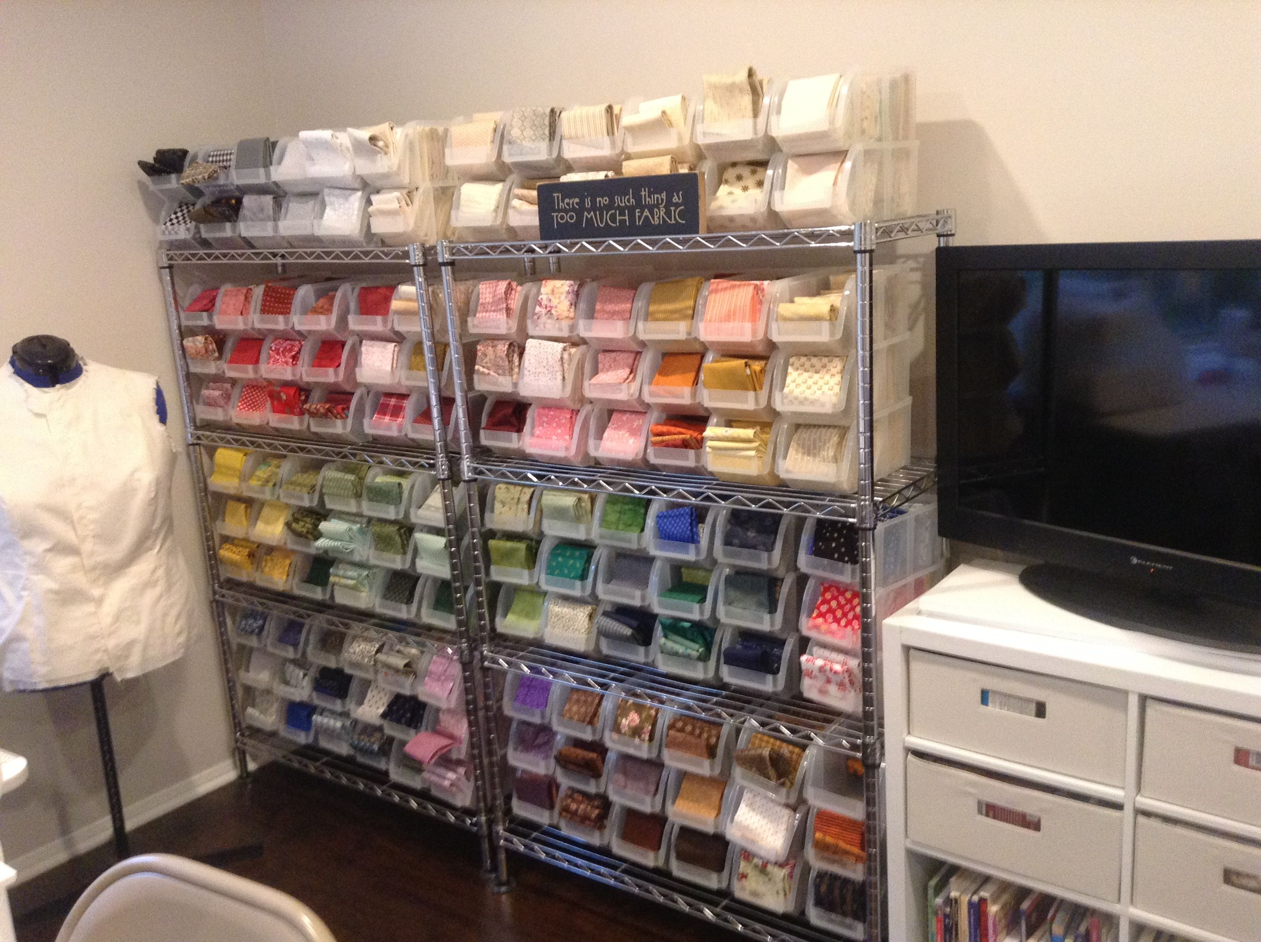 Fabric in plastic bins from joanns each holds fat quarters