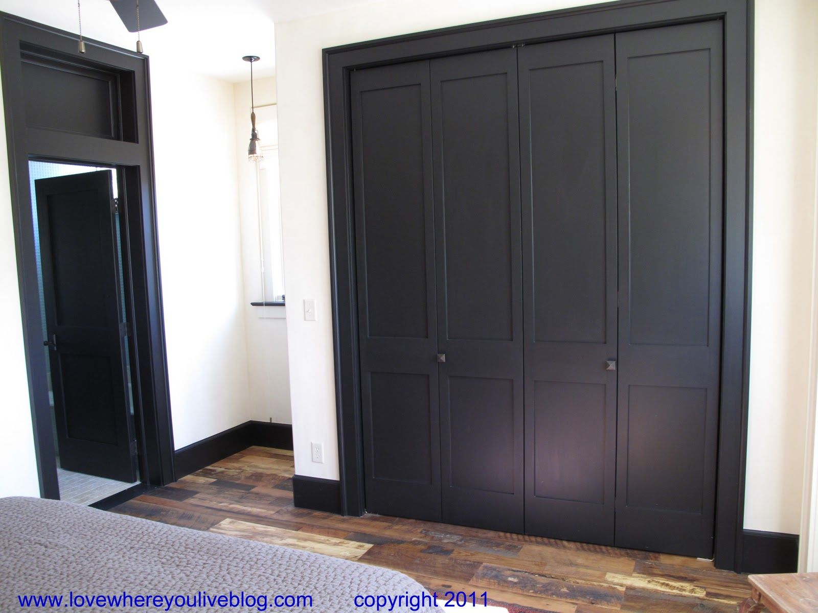 Dark trim and interior doors an ordinary bi fold door for Dark interior paint colors