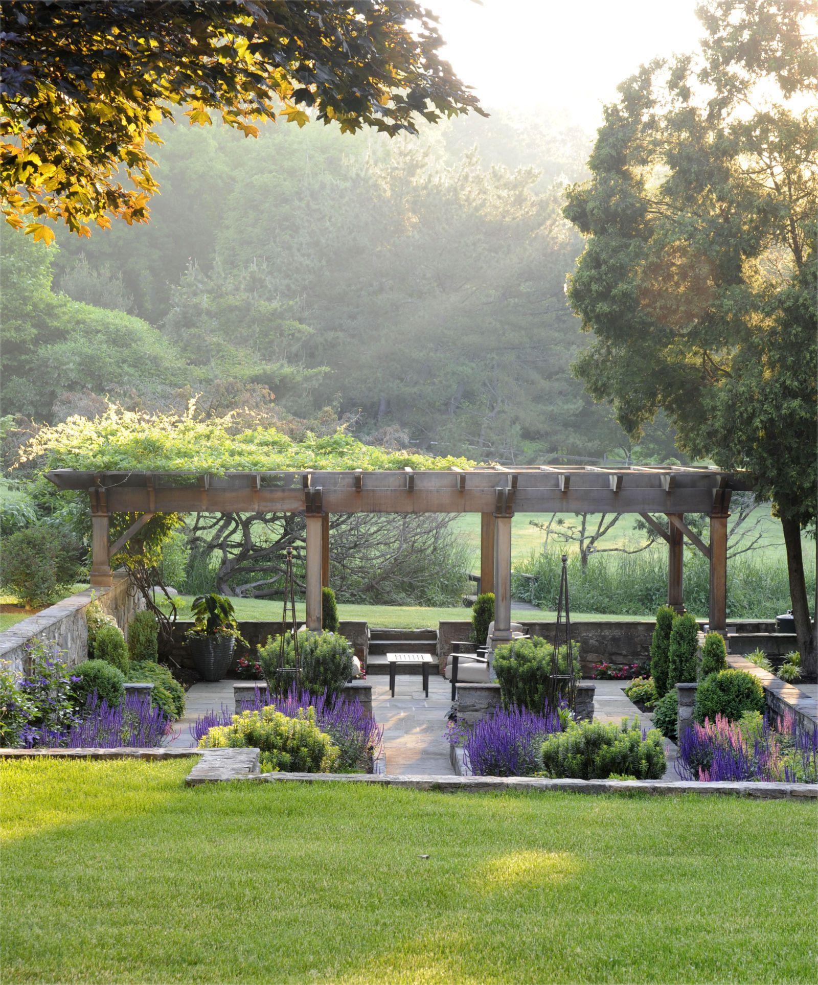 The wisteria vine on this pergola likely dates back to the 1930s.   - Veranda.com