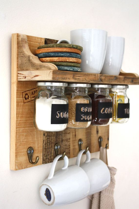 Gorgeous spices or coffee shelf with hanging jars which have chalkboard labels and hooks to hang towels, cups etc.