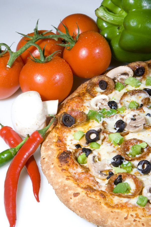 Pizza and fresh ingredients. Stilllife of pizza topped