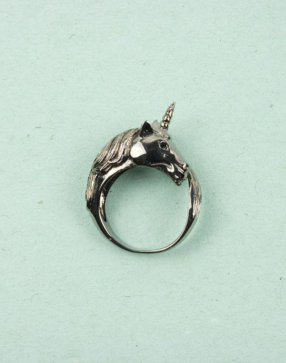 Unicorn Rhodium Ring by Modernaked... this would snag on everything, but it would be worth it haha