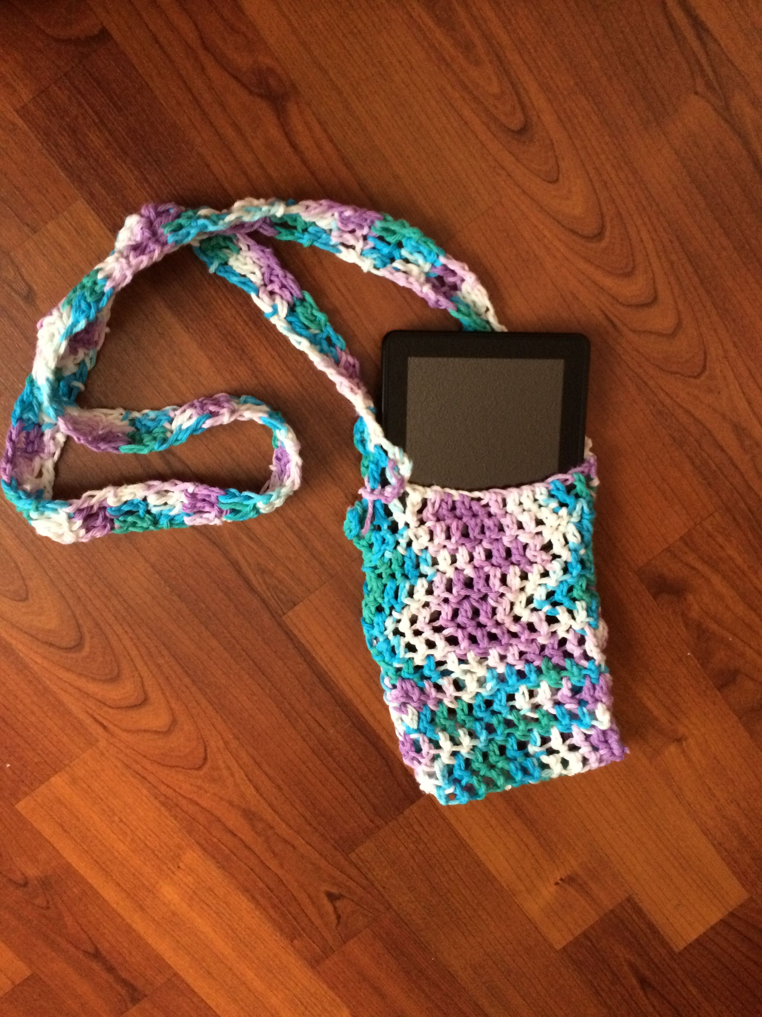 Crocheted a case for my Kindle! To make this, follow these steps: 1. Crochet a long piece of fabric, as wide a your tablet/phone and twice as long. 2. Once you are done, fold the fabric in half so it is the size of your tablet, and sew the sides together. 3. Make a strap or two and sew them to the sides. 4. Enjoy!