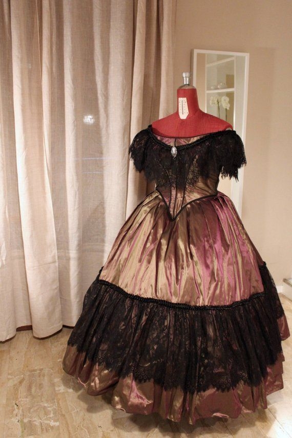 Photo of Ball gown Victorian dress with lace trimmings. 1860 ball …