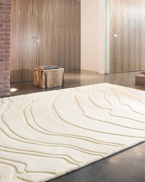 tapis haut de gamme beige create par