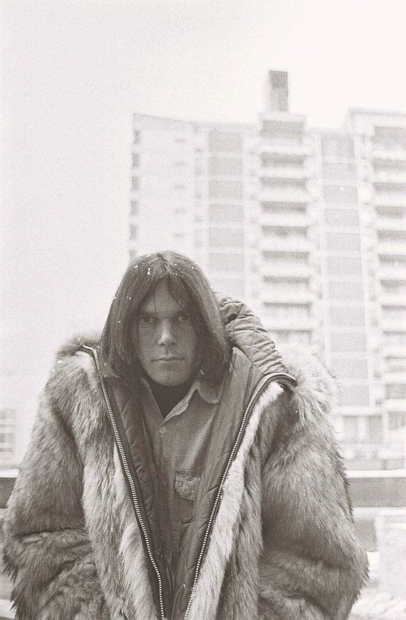 Neil Young in what looks like Winter time by Trump Towers Coney Island