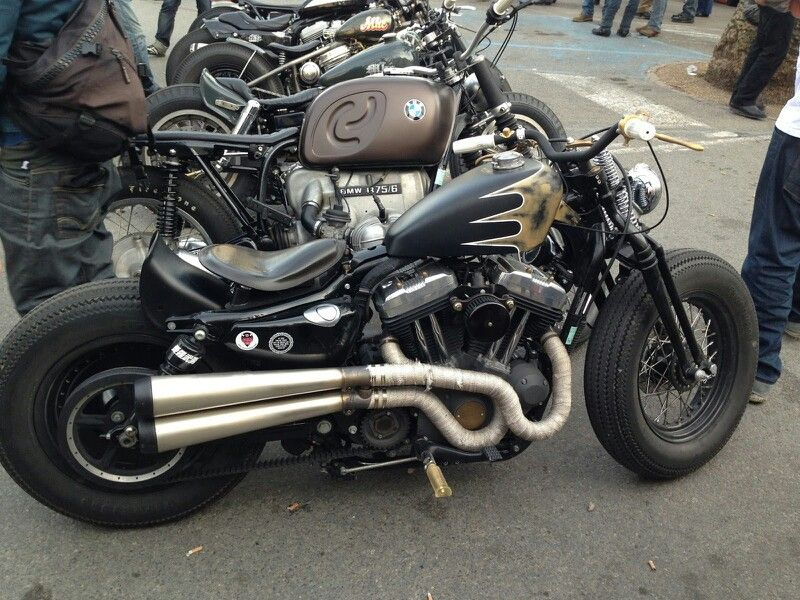 Harley 48 with springer front end, tracker exhaust (Supertrap?), and