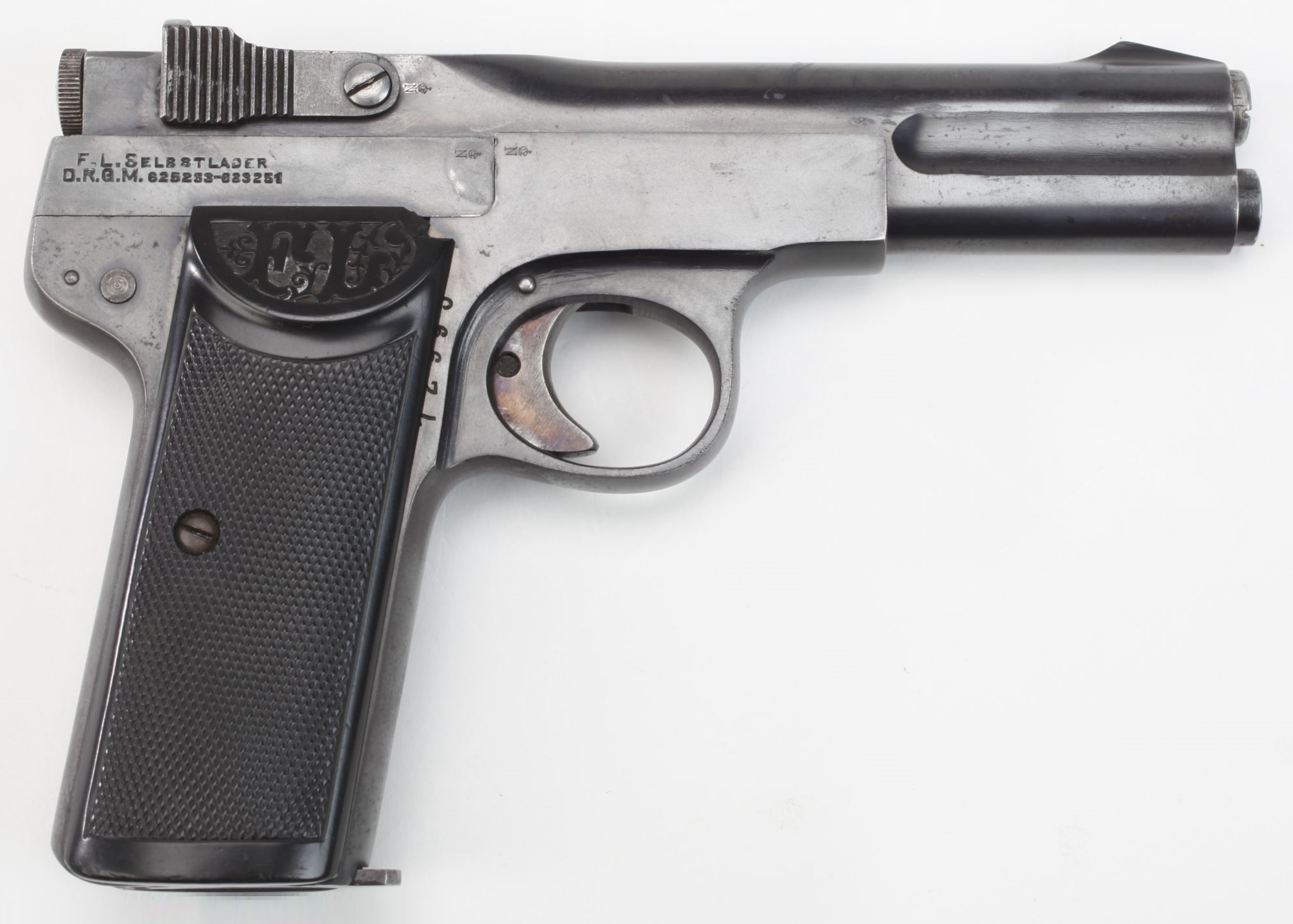 """Manufacturer: Friedrich Langenhan Model: Selbstlader (""""Self-loader"""") Finish: Blued Construction: Carbon Steel Action: Single-action Operation: Blowback, semi-automatic Type: Pistol Caliber: .32 ACP (7.65×17mm) Capacity: 7+1 Year(s) Produced: 1915-???? Quantity Produced: ?"""