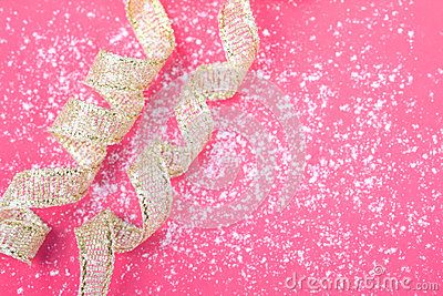 Greeting card on pink and white background with gold ribbon