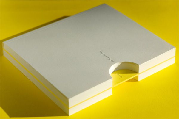 Matter Strategic Design 2011 sketchbook: half-circle die-cut, most pages blank, lovely single signature of uncut yellow pages containing text