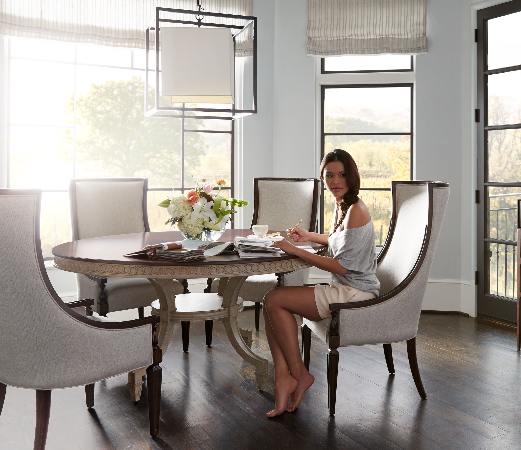 Transitional Dining Room With Roman Shades And Clean Lines