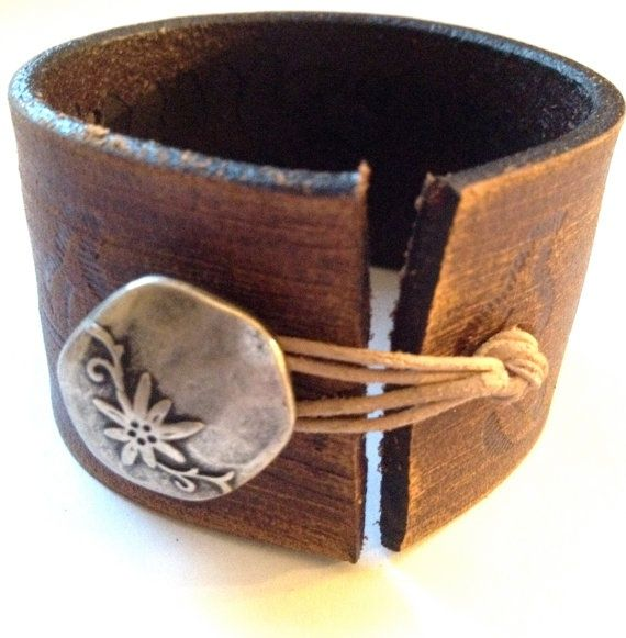 leather bracelet. would be an idea for an old belt  decorative button...