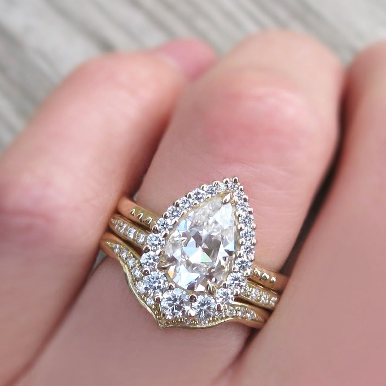 A vintage-inspired halo engagement ring. 1.5ct pear cut moissanite ...