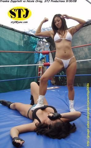 Women Wrestling Victory Pose